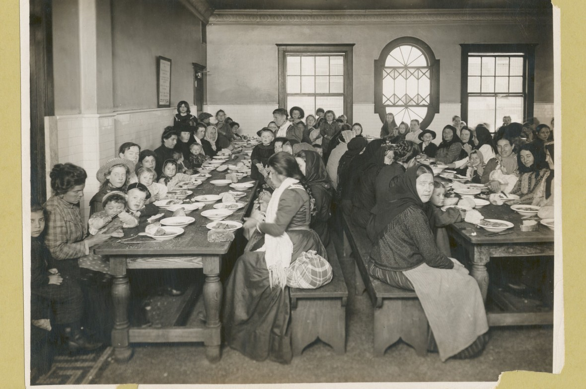 "The Miriam and Ira D. Wallach Division of Art, Prints and Photographs: Photography Collection, The New York Public Library. ""Uncle Sam, host. Immigrants being served a free meal at Ellis Island."" The New York Public Library Digital Collections. 1902 - 1913. http://digitalcollections.nypl.org/items/510d47da-d817-a3d9-e040-e00a18064a99"